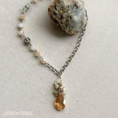 Gorgeous short brushed silver crystal necklace with teardrop pendant. An Elegant Statement necklace. One of a kind, designed by Lavish Three. Would make a great Valentine's or Mothers day gift for her! Check out our exclusive line of unique one of kind necklaces and bracelets.