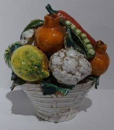 Here's a charming vintage centerpiece of vegetables in a white basket from Italy.  This would be lovely on your dining room table or displayed on a side or end table.