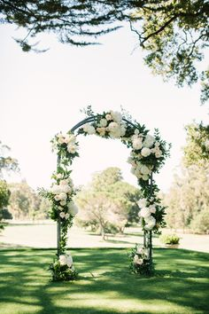 Ivory floral and garland covered wedding arch: http://www.stylemepretty.com/california-weddings/burlingame/2016/09/16/classic-outdoor-wedding-in-california/ Photography: The Edges  - http://www.theedgeswed.com/