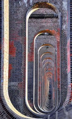 Through the arches of the Balcombe viaduct. Extraordinary early 19C architecture.
