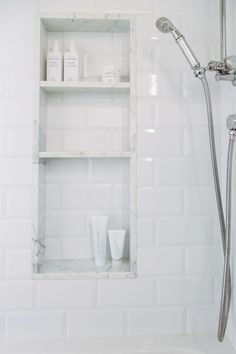Image result for Bathrooms with white subway tile and carrara marble