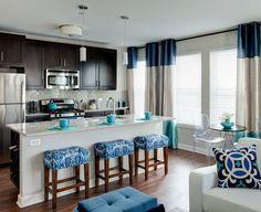 I love the colorful stools, very fun idea!Evanston Luxury Apartment Kitchen