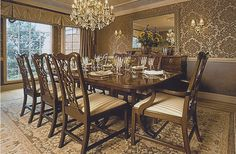 Wallpaper and a chandelier in this elegant, traditional dining room #interior #design