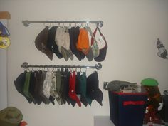 Always looking for a way to store hats!!! I would probably use S hooks for easy removal...