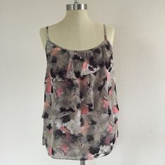 NY&C Floral tank Pretty ruffled floral tank blouse from New York and Co. Grey/pink color combo. Very lightly worn and in great condition, size medium! Great with shorts for summer ☀️  No trades No ️aypal No Merc ✅Posh Rules ✅Use Offer Button ✅Bundle for 15% off  Instagram @BeThriftyChic New York & Company Tops Tank Tops