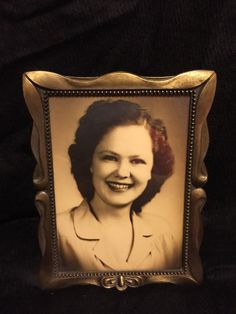 Decorate vintage! This lovely lady would make a great accent photo to your vintage decorated room. She is in a high quality Weston gallery frame.
