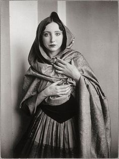 Anais Nin in Hooded Cape by Brassai 1932 I read every word this woman wrote when I was in High School.  I forgot a lot of them.  My dining room is orange and blue.  And I remember she was a Flamenco Dancer.
