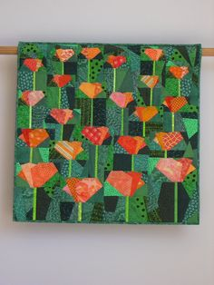 """I usually dislike """"art quilts"""".  a) art does not need to be called art  b) quilts are art c) they look like some bad 70's clothing  GOOD EXAMPLE OF WHAT AN ART QUILT SHOULD BE   California Poppies wall quilt by tinacurran on Etsy, $725.00"""