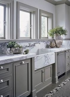 Dark grey cabinets, grey trim, light grey walls