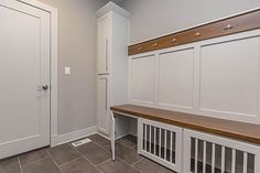 Accurate Custom Homes - Custom built-in lockers with dog kennel.
