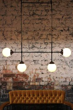 The Glass Junction Pendant Light finishes in matt black or antique bronze