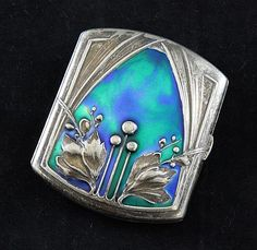 A Continental Art Nouveau silver and enamel cigarette case. Weird how I can't stand cigarettes/smoking, but I love novelty items related to it... pretty cases and funky ash trays...