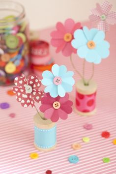 Heart flowers in spool vases.