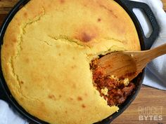 Hearty chili and a homemade cornbread baked into one delicious skillet. Chili Cornbread Skillet - BudgetBytes.com