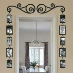 Framing around a door for photos hanging on each side of the door. Love this idea!