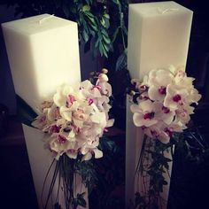 Wedding arrangements by Fleurs   Greek Orthodox wedding candles with orchids
