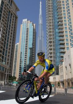 The riders were dwarfed by the huge skyscrapers in Dubai Photo: © ANSA/Peri-Carcone