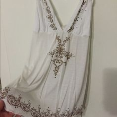 White Top with Sequins Small white top. Worn a couple of times. Tops Tank Tops