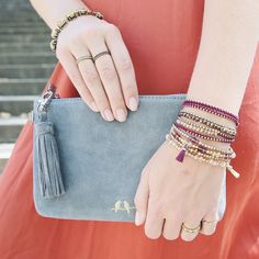 Our new soft suede clutch in soft gray is all you need to seize the day. Well, that + some of our signature wrap bracelets, of course!