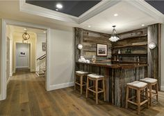 The bar is entirely made of reclaimed barnwood. Isn't this fun? Light fixture is from Restoration Hardware.
