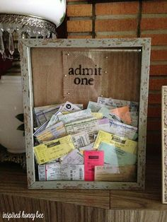 I love the idea of displaying a shadow box or jar filled with ticket stubs. Oh, memories!