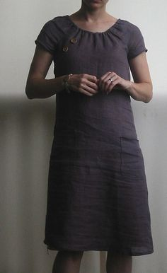 Peasanty... but simpler, fewer gathers, slicker and with some nice buttons for detail. And pockets. Yes.  Simplicity 3835