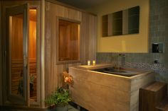 A traditional wooden box-style ofuro. This bathroom is a real-deal personal spa, complete with sauna. I want this!!