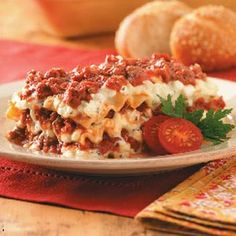 An absolute MUST! By far, the best lasagna recipe I have ever tried. I changed the layers a little by doing only 2 thicker layers, rather than 3, and making the top a layer of mozzarella cheese. Yum!!