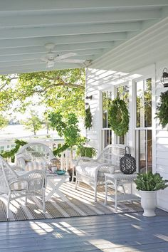 New first- and second-story porches brought back essential farmhouse charm to the 19th-century home.