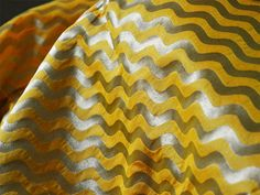 This is a beautiful pure benarse silk brocade wave pattern design fabric in Yellow and Gold. The fabric illustrate golden woven waves on yellow background.  You can use this fabric to make...