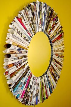 Magazine Mirror. This would also work for a holiday wreath. I love the thought of recycling old magazines into something else.
