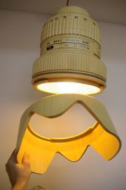 Beautiful lamp designed and created by Monoculo looks like a camera lens.
