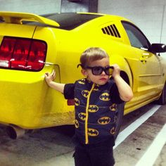 yeah that's right, son't mess with me, cause I'm.....BATMAN (with a bright yellow sports car)