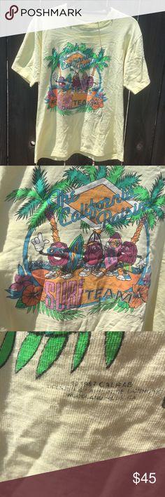 "VTG 1987 California Raisins tshirt yellow SZ L VTG 1987 California Raisins tshirt yellow SZ L- ARMPIT TO ARMPIT 20"" FRONT LENGTH 23"" some spots and holes see pix-great tshirt!! Vintage Tops Tees - Short Sleeve"