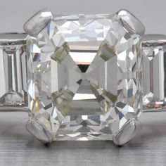 my ring as it currently is 2.05 c (2.25c tw) ascher cut diamond with two emerald cut side diamonds set in platinum.  Early 1930's antique vintage art deco conflict free diamond