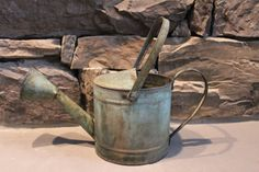 This won't last long!  Nice Rustic Tin Metal Watering Can / by henhousedesignstudio