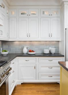 white kitchen cabinets black countertops and white subway tile with