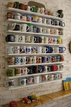 I need a wall like this. But I don't have room in my kitchen.   33 Signs That Coffee Owns You