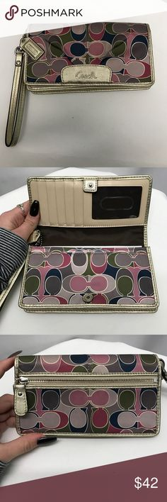 COACH wallet Multicolored printed cloth Coach wallet with gold leather accents and gold hardware. Snap closure that opens to an ID slot, 5 card slots & two large spaces for dollar bills. In addition a back zipper pocket. Coach Bags Wallets