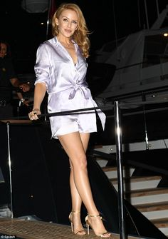 Flawless: The Spinning Around hitmaker added height to her frame with a pair of towering strappy gold sandals, while wearing her golden locks coiffed to perfection