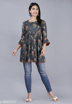 Checkout this latest Tops & Tunics Product Name: *Women's Printed Short Top* Fabric: Rayon Sleeve Length: Three-Quarter Sleeves Pattern: Printed Multipack: 1 Sizes: S (Length Size: 33 in)  Country of Origin: India Easy Returns Available In Case Of Any Issue   Catalog Rating: ★4.2 (205)  Catalog Name: Urbane Designer Women Tops & Tunics CatalogID_1450029 C79-SC1020 Code: 973-8562337-459