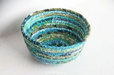 Combine with tutorial on making fabric twine, then twist the twine into a bowl. No rope needed, just fabric.