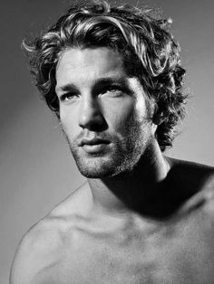 Mid length curly hair style for men