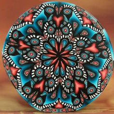 Black Red and Blue Circle Kaleidoscope Polymer Clay by ikandiclay,