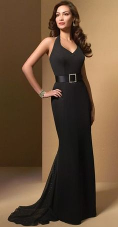 Long black beautiful gown. I especially love the belted waist and the black sparkly train.
