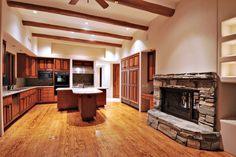 A fireplace in the kitchen! Realty Executives International Unique Kitchens Listing at 9643 E CALLE DE VALLE DRIVE in Scottsdale, AZ.