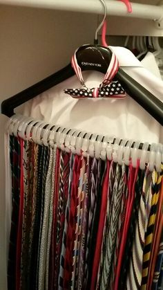 Hanging ties. Neckties. Storage. Just three packs of Walmart shower curtain rings. And one hefty hanger. Ten minutes and three dollars. Easy to see each tie. Stores easily in closet.