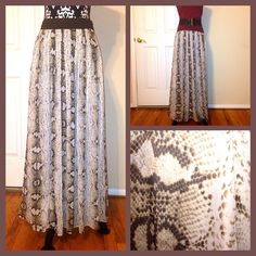 """‼️2016 SALE‼️Snakeskin Print Skirt Chiffon like fully lined. In perfect condition minus the sides of the top band from hanger as seen in 3rd photo. Skirt is floor length for someone 5'5"""" wearing flats. I'm 5'4"""" so had to roll it once. Hardly noticeable with a top and once belted. Price is firm White House Black Market Skirts"""