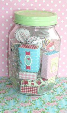 This would be a fun gift... filled with decorated matchboxes... paper ornaments... and candies.