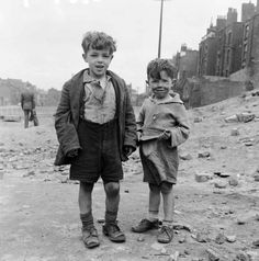 Children of Liverpool playing in a bomb site left since the end of the Second World war. 5th August 1954